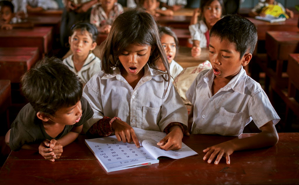 Education can change the course of a child's life. Here a group of students read the alphabet at a Save the Children supported school in Cambodia.