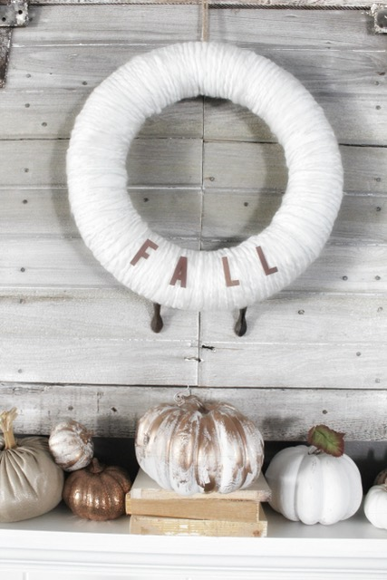 fall mantle decor with painted pumpkins