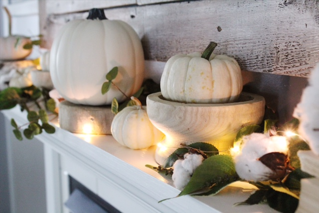 fall mantle decor with white pumpkins