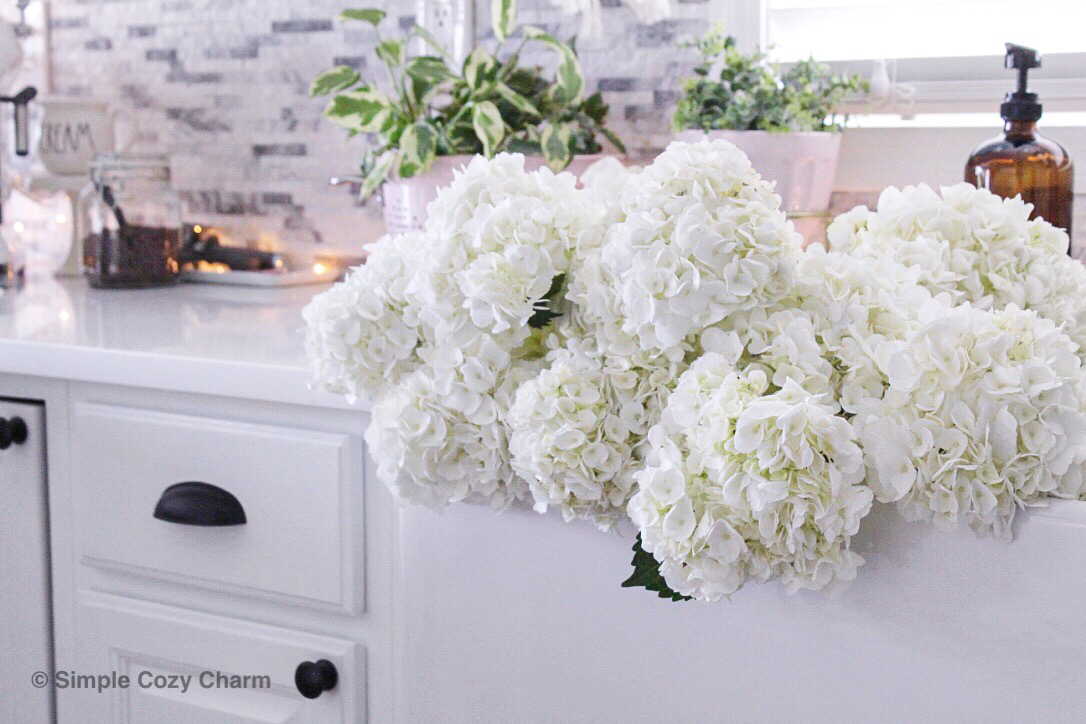 farmhouse sink full of dollar hydrangeas