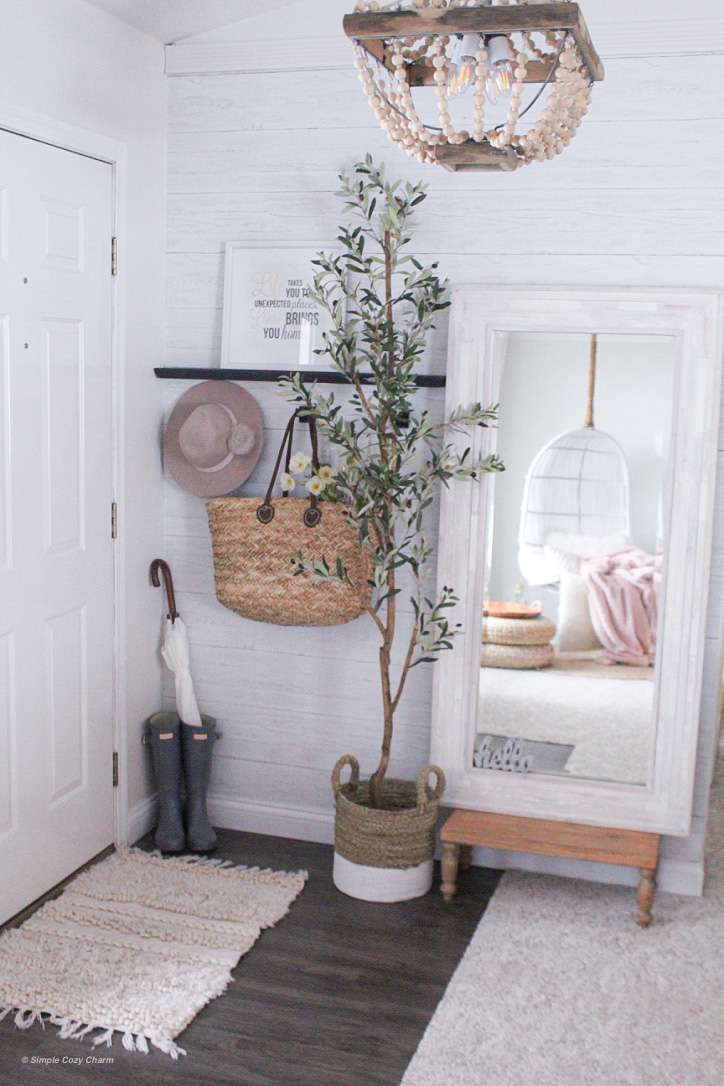 slender faux olive tree is perfect for tight spaces